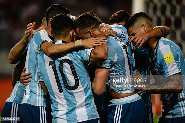 Argentina's Ramiro Funes Mori celebrates with teammates after scoring against Peru during their Russia 2018 World Cup football qualifier match in...