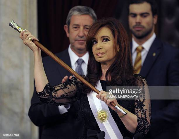 Argentina's reelected President Cristina Kirchner with the presidential sash and stick after her inauguration in Buenos Aires on December 10 2011...