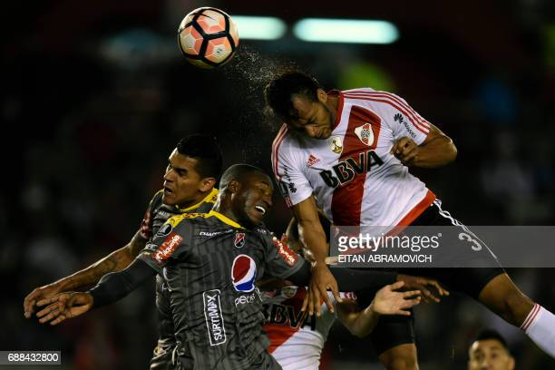 TOPSHOT Argentina's River Plate defender Arturo Mina vies for the ball with Colombia's Deportivo Independiente Medellin midfielder Yairo Moreno and...