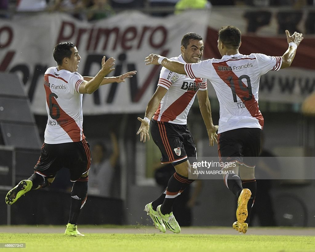 Argentina's River Plate defender <a gi-track='captionPersonalityLinkClicked' href=/galleries/search?phrase=Gabriel+Mercado&family=editorial&specificpeople=4110696 ng-click='$event.stopPropagation()'>Gabriel Mercado</a> (C) celebrates with teammates forward <a gi-track='captionPersonalityLinkClicked' href=/galleries/search?phrase=Teofilo+Gutierrez&family=editorial&specificpeople=5901237 ng-click='$event.stopPropagation()'>Teofilo Gutierrez</a> (R) and defender Ramiro Funes Mori after scoring a goal against Peru's Juan Aurich during the Copa Libertadores 2015 group 6 football match at the 'Monumental' stadium in Buenos Aires, Argentina, on March 19, 2015. AFP PHOTO / JUAN MABROMATA