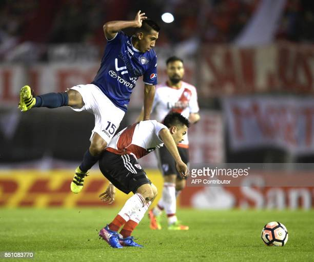 Argentina's River Plate forward Gonzalo Martinez vies for the ball with Bolivia's Wilstermann midfielder Cristhian Machado during their Copa...