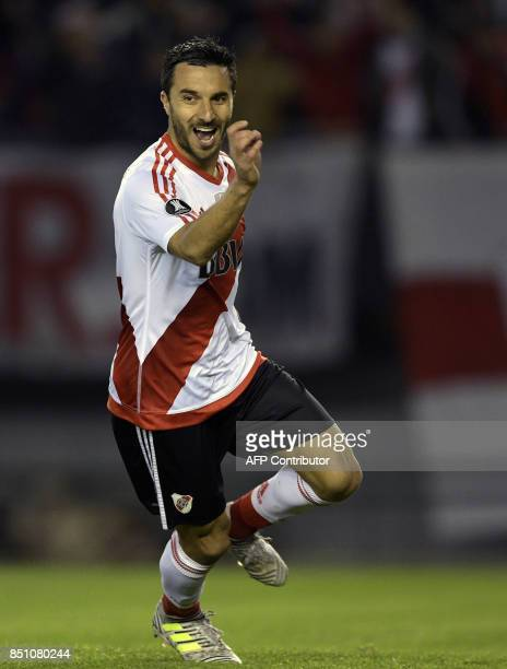 Argentina's River Plate forward Ignacio Scocco celebrates after scoring his fourth and the team's fifth goal against Bolivia's Wilstermann during the...
