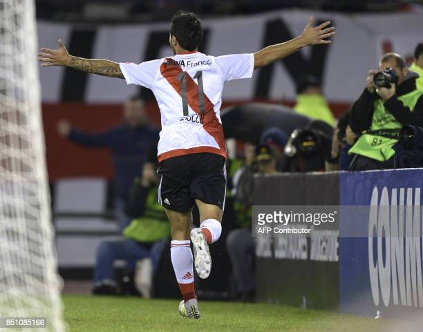Argentina's River Plate forward Ignacio Scocco celebrates after scoring his fifth and the team's seventh goal against Bolivia's Wilstermann during...