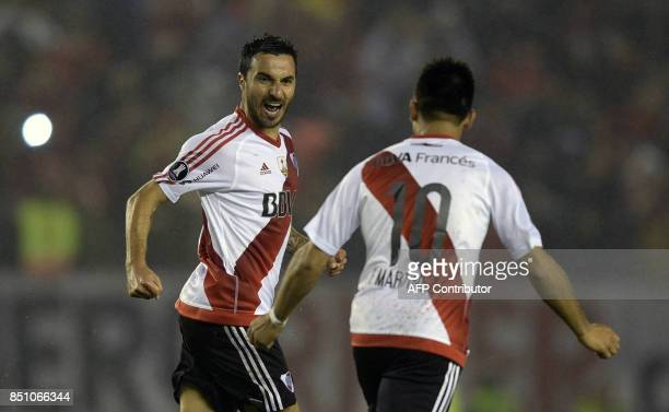 Argentina's River Plate forward Ignacio Scocco celebrates next to teammate forward Gonzalo Martinez after scoring the team's second goal against...