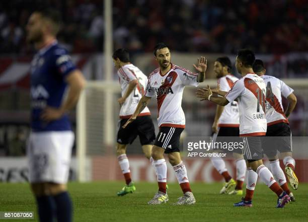 Argentina's River Plate forward Ignacio Scocco celebrates next to teammate forward Gonzalo Martinez after scoring the team's third goal against...