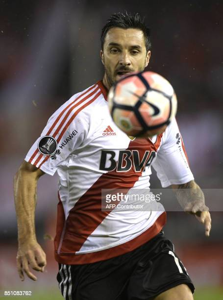 Argentina's River Plate forward Ignacio Scocco eyes the ball during the Copa Libertadores 2017 quarterfinals second leg football match against...