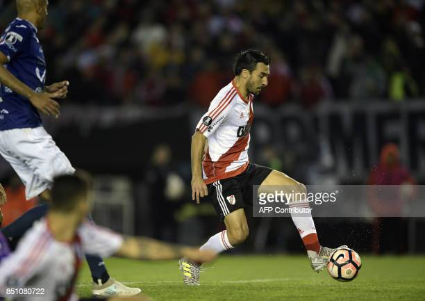 Argentina's River Plate forward Ignacio Scocco strikes to score his fourth and the team's fifth goal against Bolivia's Wilstermann during the Copa...