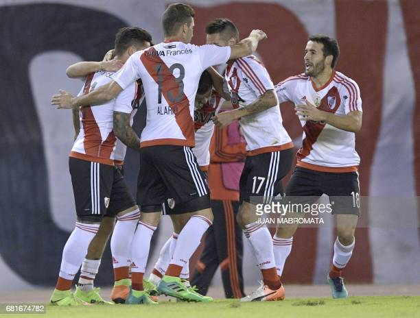 Argentina's River Plate forward Rodrigo Mora celebrates with teammates after scoring a penalty kick against Ecuador's Emelec during the Copa...
