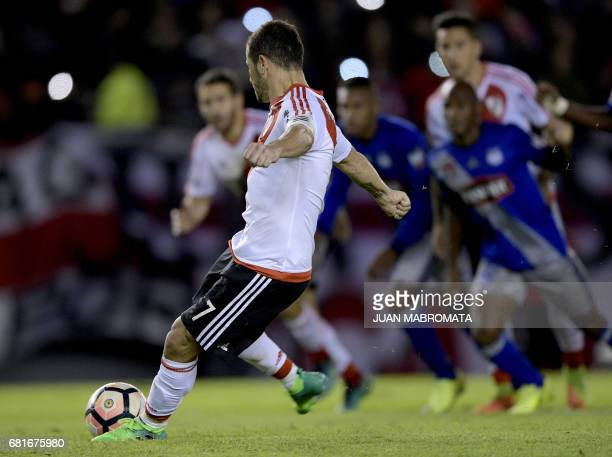 Argentina's River Plate forward Rodrigo Mora strikes a penalty to score against Ecuador's Emelec during their Copa Libertadores 2017 group 3 football...