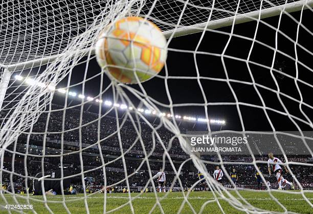 Argentina's River Plate midfielder Carlos Sanchez celebrates after scoring a penalty shot against Argentina's Boca Juniors during the Copa...