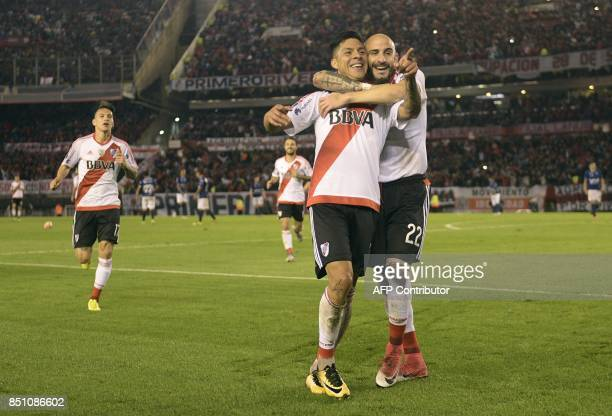 Argentina's River Plate midfielder Enzo Perez celebrates with teammate defender Javier Pinola after scoring his second and team's eighth goal against...