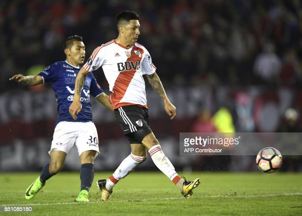 Argentina's River Plate midfielder Enzo Perez strikes to score his second and the team's eighth goal against Bolivia's Wilstermann during the Copa...