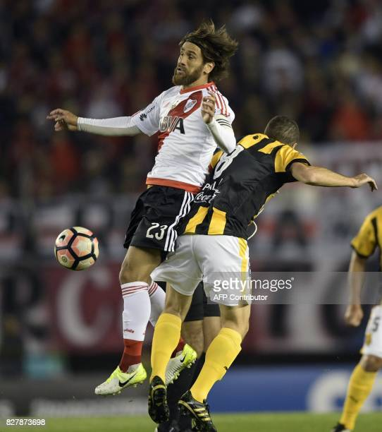 Argentina's River Plate midfielder Leonardo Ponzio vies for the ball with Paraguay's Guarani midfielder Marcelo Palau during the Copa Libertadores...