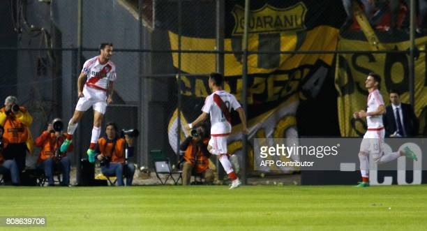 Argentina's River Plate player Ignacio Scocco celebrate his goal against Paraguay's Guarani during their Copa Libertadores 2017 match at the...