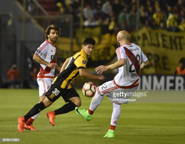 Argentina's River Plate player Javier Pinola vies for the ball with Antonio Marin of Paraguay's Guarani during their Copa Libertadores 2017 football...