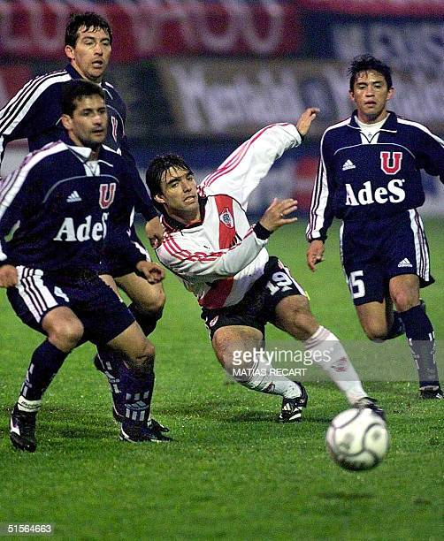 Argentina's River Plate player Martin Cardetti chases the ball with Universidad de Chile players Ronald Fuentes Cristian Mora and David Reyes 12...