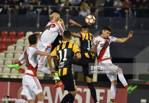 Argentina's River Plate player Milton Casco vies for the ball with Luis Cabral of Paraguay's Guarani during their Copa Libertadores 2017 football...
