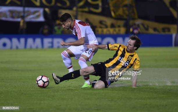 Argentina's River Plate player Milton Casco vies for the ball with Hernan Novik of Paraguay's Guarani during their Copa Libertadores 2017 football...