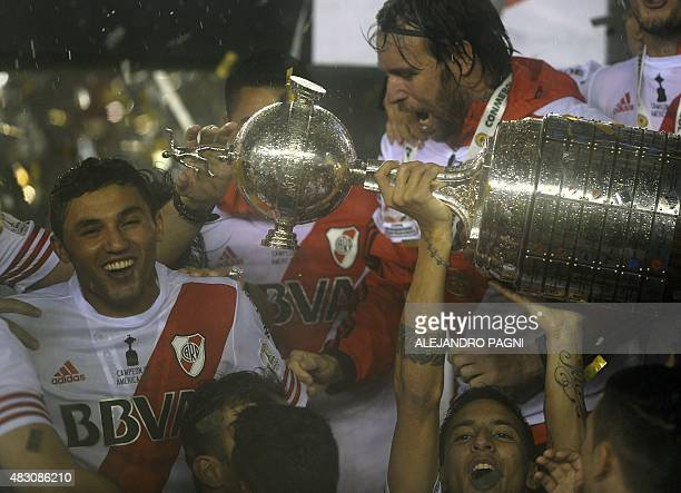 Argentina's River Plate players celebrate with the Libertadores Cup trophy after defeating Mexico's Tigres 30 in the final at Americo Vespucio...