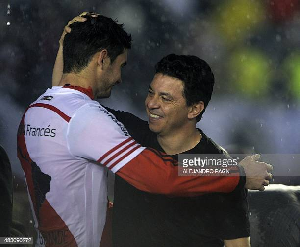 Argentina's River Plate's coach Marcelo Gallardo and forward Lucas Alario approach to embrace after the Libertadores Cup second leg final match...