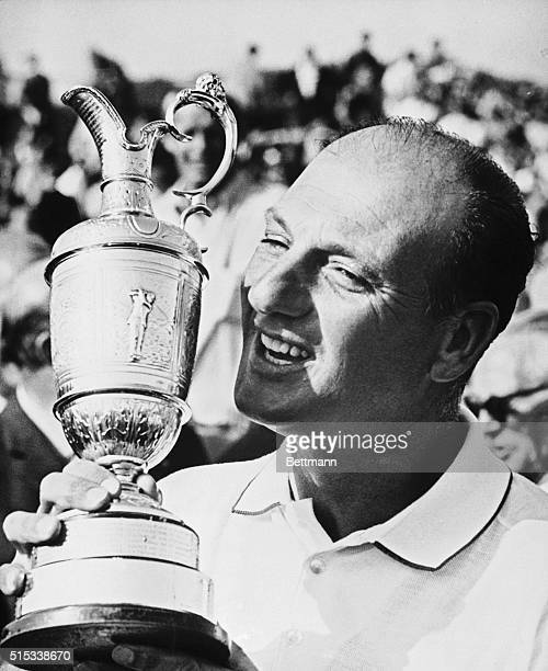 Argentina's Robert De Vicenzo gives big grin as he prepares to kiss trophy after winning final round of British Open Golf Championships here July...