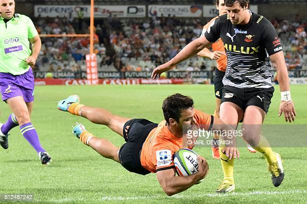 Argentina's Rodrigo Baez of the Jaguares dives with the ball during their Super Rugby match against the South Africa's Cheetahs on February 26 2016...