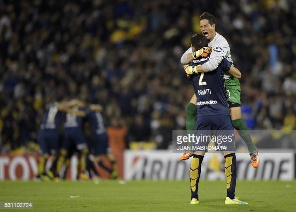 Argentina's Rosario Central goalkeeper Sebastian Sosa and defender Alejandro Donatti celebrates after teammate midfielder Walter Montoya upon scoring...