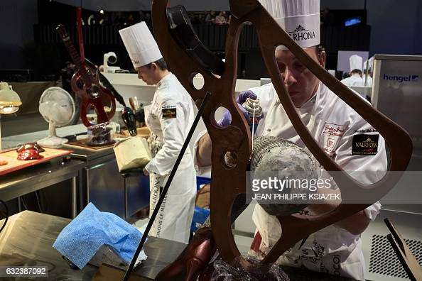 Argentina's Rubben Darre competes during the Pastries World Cup final on January 22 2017 in Chassieu outside Lyon as part of the Catering and Food...