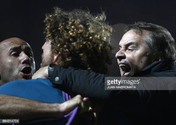 Argentina's San Lorenzo coach Diego Aguirre celebrates with defender Fabricio Coloccini and midfielder Juan Mercier after midfielder Fernando...