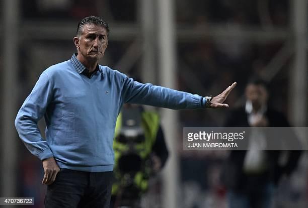 Argentina's San Lorenzo coach Edgardo Bauza gestures during the Copa Libertadores 2015 group 2 football match against Uruguay's Danubio at Pedro...