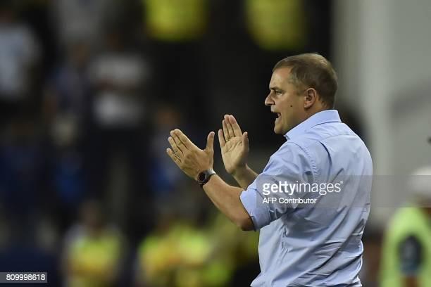 Argentina's San Lorenzo coach Uruguay's Diego Aguirre gestures during their 2017 Copa Libertadores football match against Ecuador's Emelec at George...