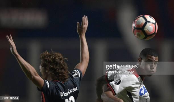 Argentina's San Lorenzo defender Matias Corujo vies for the ball with Brazil's Atletico Paranaense defender Sidcley during their Copa Libertadores...