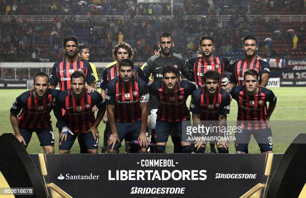 Argentina's San Lorenzo football team players pose before their Copa Libertadores 2017 group 4 football match against Brazil's Atletico Paranaense at...