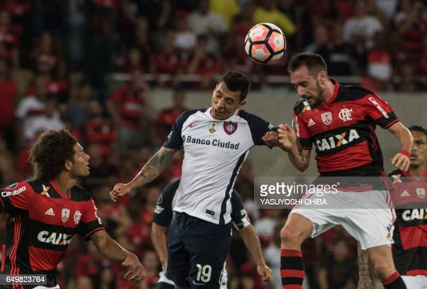 Argentina's San Lorenzo footballer Ruben Botta jumps for the ball with Brazil's Flamengo Mancuello during their Libertadores Cup football match at...