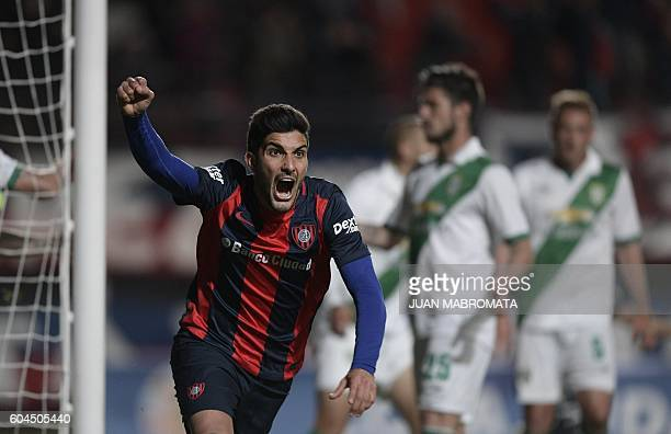 Argentina's San Lorenzo forward Nicolas Blandi celebrates after scoring the team's second goal against Argentina's Banfield during their Copa...