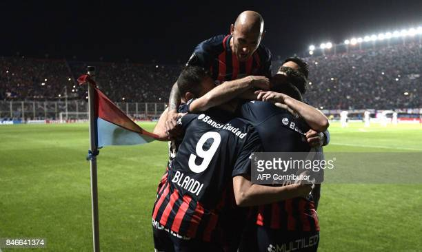 Argentina's San Lorenzo forward Nicolas Blandi celebrates with teammates after scoring his second goal against Argentina's Lanus during the Copa...