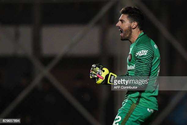 Argentina's San Lorenzo goalkeeper Nicolas Gaston Navarro reacts after saving a penalty during the Copa Libertadores 2017 round of 16 second leg...