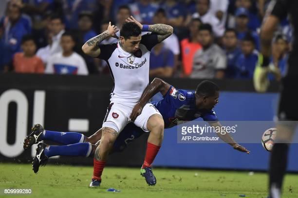 Argentina's San Lorenzo Luis Avila vies for the ball with Romario Caicedo of Ecuador's Emelec during their 2017 Copa Libertadores football match at...