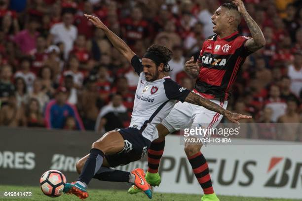 Argentina's San Lorenzo Marcos Angeleri vies the ball with Brazil's Flamengo Guerrero during their Libertadores Cup football match against...