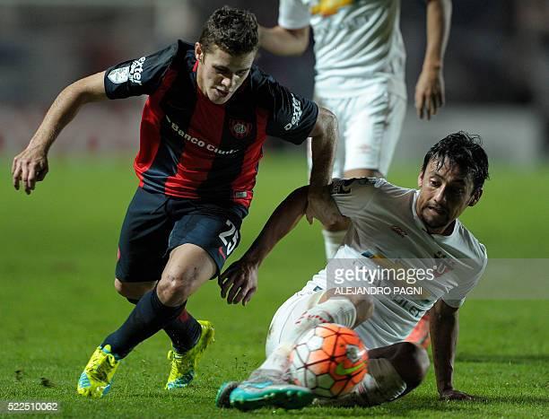 Argentina's San Lorenzo midfielder Bautista Merlini vies for the ball with Ecuador's Liga Universitaria de Quito midfielder Edison Vega during their...