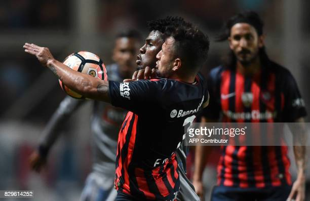 Argentina's San Lorenzo midfielder Franco Gabriel Mussis vies for the ball with Ecuador's Emelec forward Marlon de Jesus during their Copa...