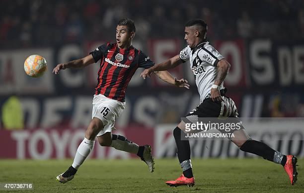 Argentina's San Lorenzo midfielder Hector Villalba vies for the ball with Uruguay's Danubio midfielder Alan Ruiz during their Copa Libertadores 2015...