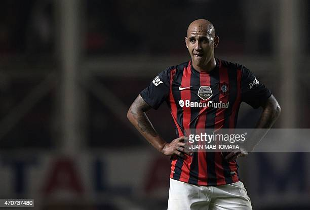 Argentina's San Lorenzo midfielder Juan Mercier gestures during the half time of their Copa Libertadores 2015 group 2 football match against...