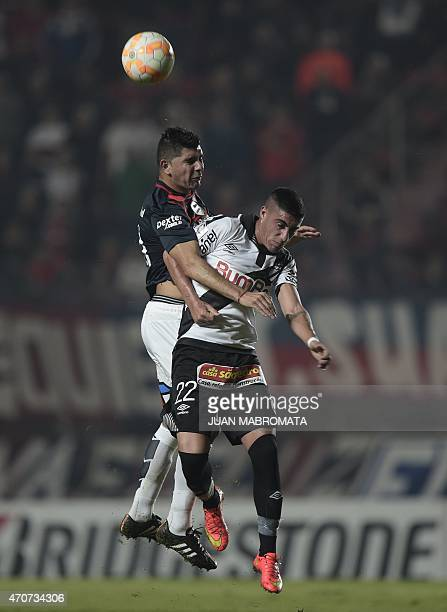 Argentina's San Lorenzo midfielder Nestor Ortigoza vies for the ball with Uruguay's Danubio defender Emiliano Ghan during their Copa Libertadores...