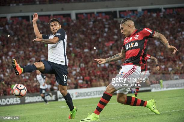 Argentina's San Lorenzo Paulo Diaz tries to block Brazil's Flamengo Guerrero during their Libertadores Cup football match at Maracana stadium in Rio...