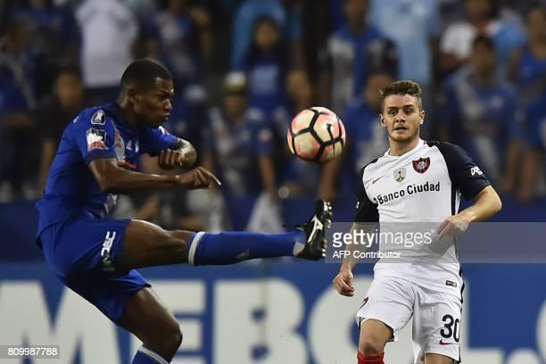 Argentina's San Lorenzo player Bautista Merlini vies for the ball Romario Caicedo of Ecuador's Emelec during their 2017 Copa Libertadores football...