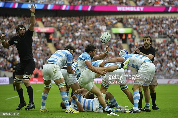 Argentina's scrum half Tomas Cubelli kicks the ball during a Pool C match of the 2015 Rugby World Cup between New Zealand and Argentina at Wembley...