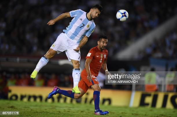 Argentina's Sergio Aguero and Chile's defender Mauricio Isla vie for the ball during their 2018 FIFA World Cup qualifier football match at the...