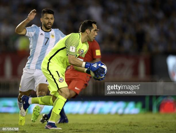 Argentina's Sergio Aguero and Chile's goalkeeper Claudio Bravo vie for the ball during their 2018 FIFA World Cup qualifier football match at the...