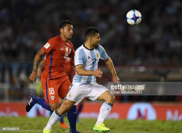 Argentina's Sergio Aguero and Chile's Gonzalo Jara vie for the ball during their 2018 FIFA World Cup qualifier football match at the Monumental...